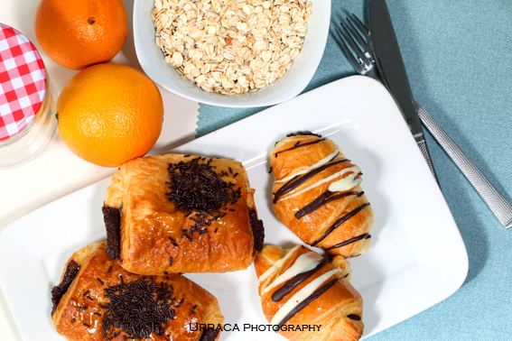 Breakfast with oat flakes oranges and chocolate buns